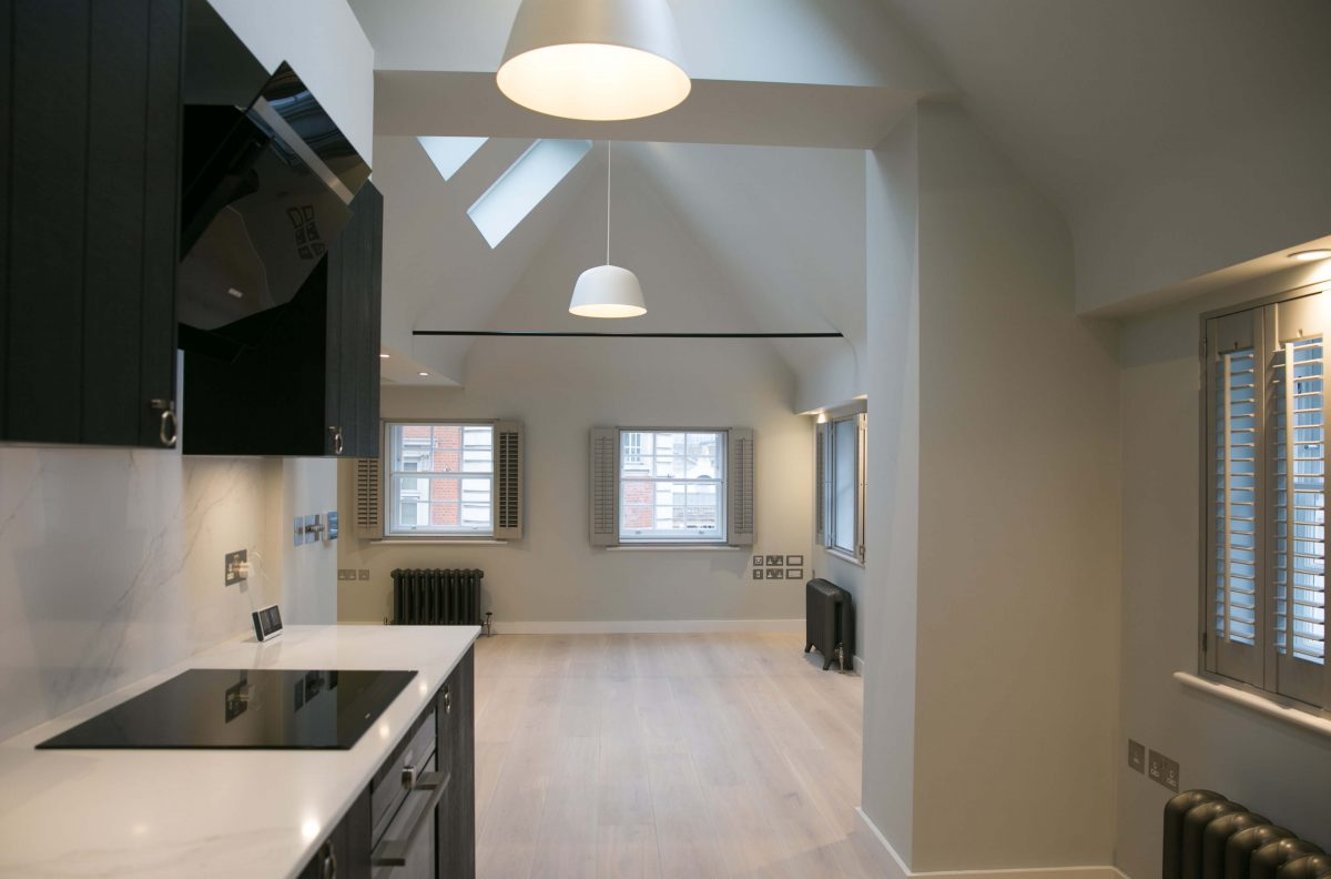 modern and classic black and white kitchen, black cabinets and sink, white walls