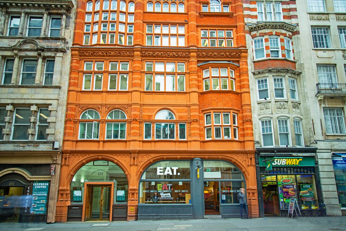 tangerine building with Eat dining
